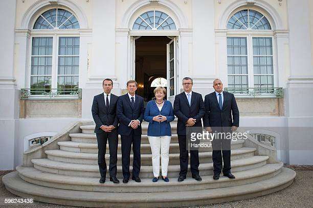 In this handout photo provided by the German Government Press Office German Chancellor Angela Merkel receives Prime Minister of Austria Christian...