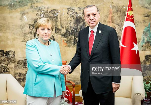 In this handout photo provided by the German Government Press Office German chancellor Angela Merkel meets the Turkish president Recep Tayyip Erdogan...