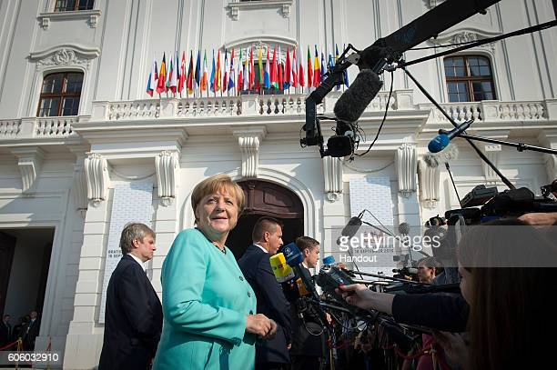 In this handout photo provided by the German Government Press Office German Chancellor Angela Merkel arrives to give a statement on arrival for the...