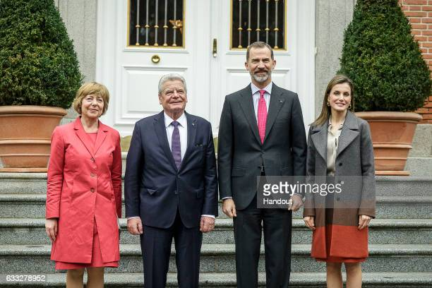 In this handout photo provided by the German Government Press Office King Felipe of Spain and Queen Letizia of Spain receive President of Germany...