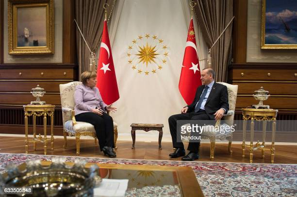 In this handout photo provided by the German Government Press Office Turkish President Recep Tayyip Erdogan and Federal Chancellor of Germany Angela...
