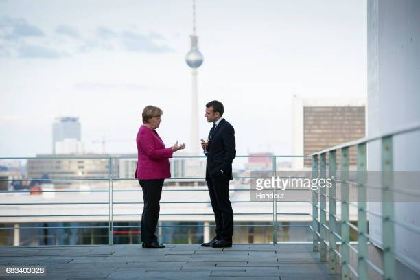 In this handout photo provided by the German Government Press Office , German Chancellor Angela Merkel talks with newly-elected French President...