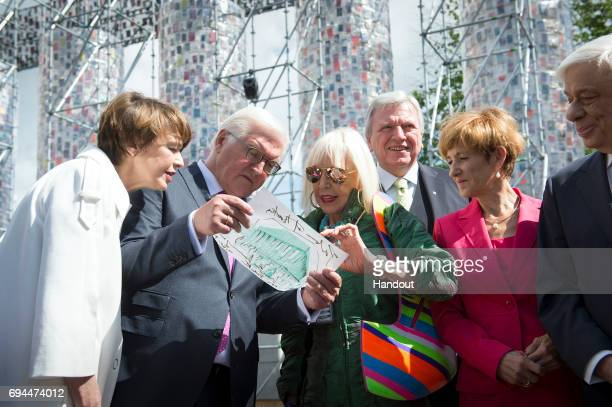 In this handout photo provided by the German Government Press Office Federal President FrankWalter Steinmeier his wife Elke Buedenbender and Hessian...