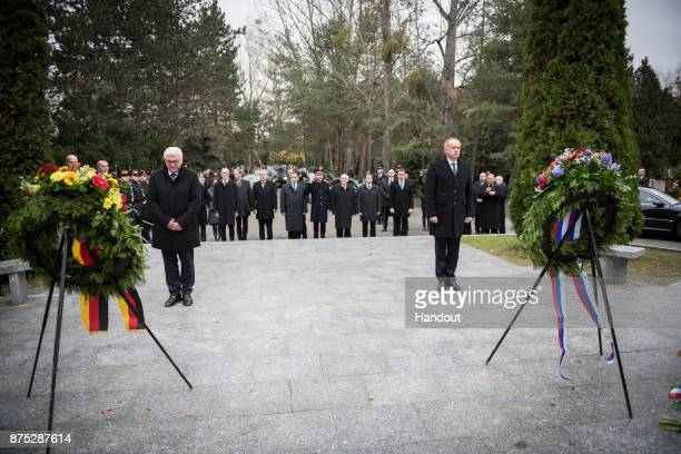 In this handout photo provided by the German Government Press Office German President FrankWalter Steinmeier and Slovakian President Andrej Kiska lay...