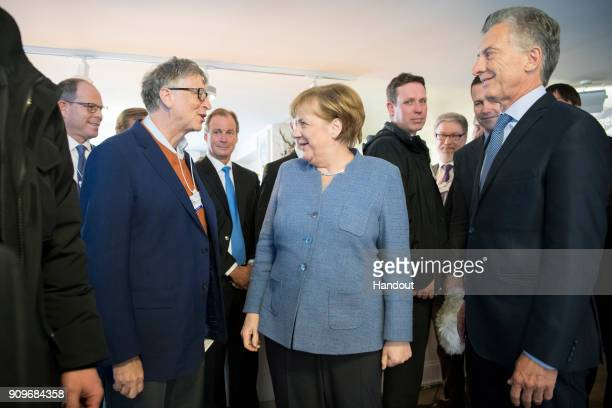 In this handout photo provided by the German Government Press Office Chancellor Angela Merkel Argentine President Mauricio Macri and Microsoft...
