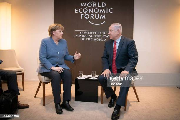 In this handout photo provided by the German Government Press Office Chancellor Angela Merkel and Israeli Prime Minister Benjamin Netanyahu at the...