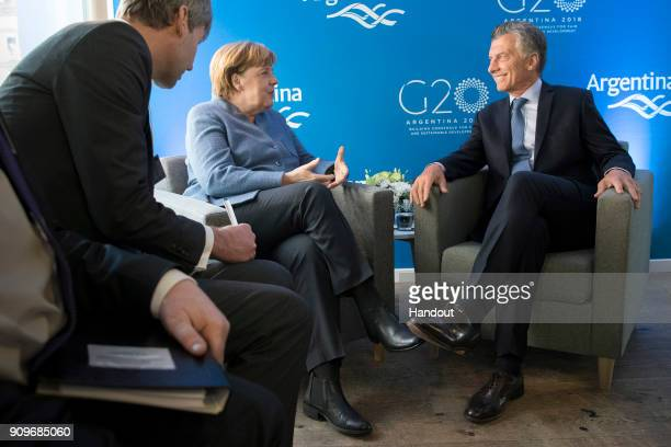In this handout photo provided by the German Government Press Office Chancellor Angela Merkel and Argentine President Mauricio Macri at the beginning...