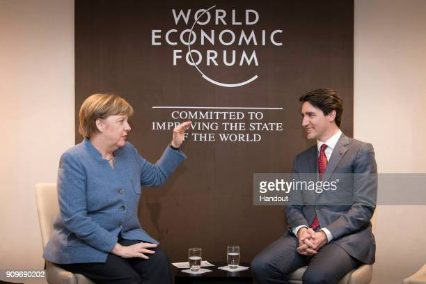 In this handout photo provided by the German Government Press Office Chancellor Angela Merkel and Prime Minister of Canada Justin Trudeau speak at...