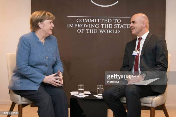 In this handout photo provided by the German Government Press Office Chancellor Angela Merkel and Swiss Federal President Alain Berset speak at the...