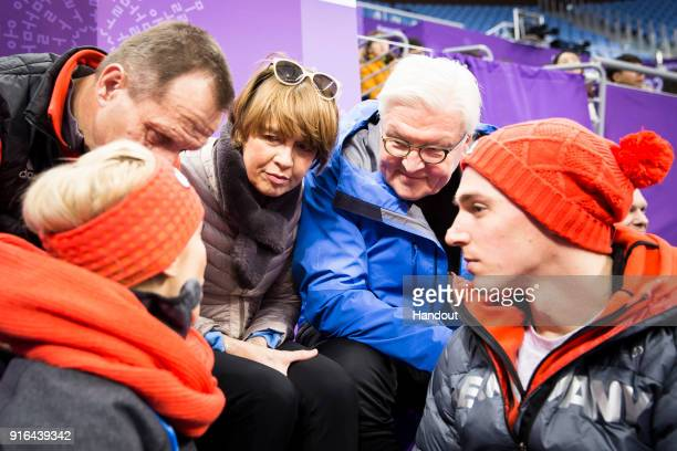 In this handout photo provided by the German Government Press Office German President FrankWalter Steinmeier and Elke Büdenbender in conversation...