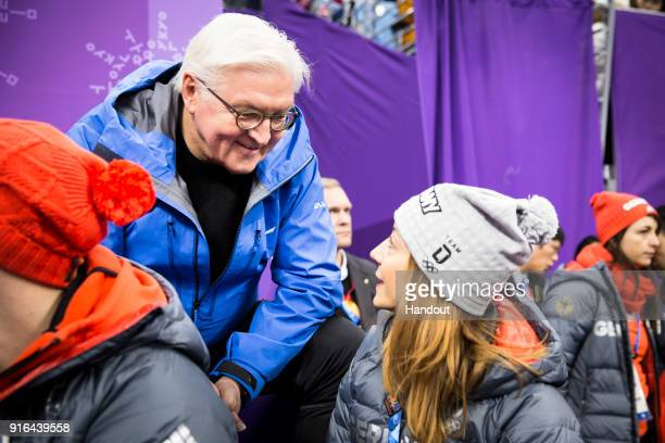 In this handout photo provided by the German Government Press Office German President FrankWalter Steinmeier in conversation with figure skater...