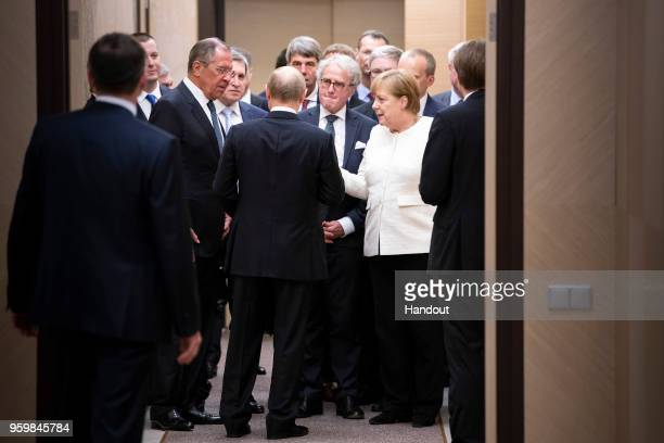 In this handout photo provided by the German Government Press Office German Chancellor Angela Merkel Russian Foreign Minister Sergej Lawrow and...