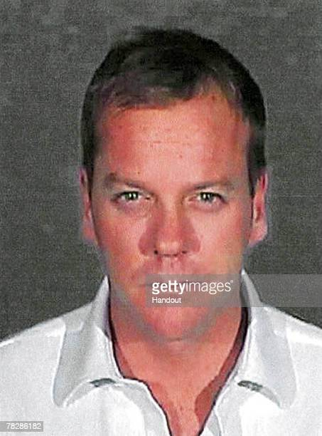 In this handout photo provided by the Glendale City Police Department actor Kiefer Sutherland poses for his mugshot photo at Glendale City Jail...