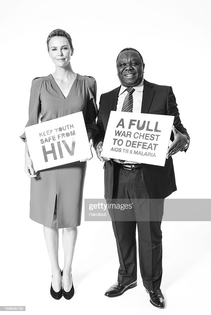 In this handout photo provided by The Global Fund, HIV and AIDS campaigner Charlize Theron and Zimbabwean Prime Minister Morgan Tsvangirai pose for a photo at The Global Fund's Big Push campaign at the opening of the World Economic Forum Anual Meeting on January 22, 2013 in Davos, Switzerland.