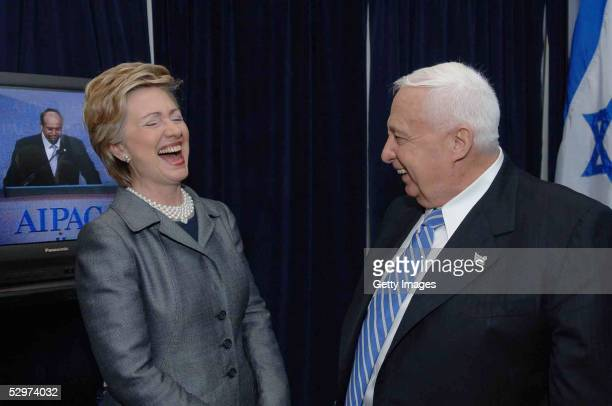 In this handout photo provided by the GPO US Sen Hillary Rodham Clinton shares a laugh with Israeli Prime Minister Ariel Sharon at the annual...