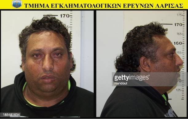 In this handout photo provided by the Hellenic Police 39 yearold Christos Salis poses for his mugshot on October 21 2013 The Roma couple are due to...
