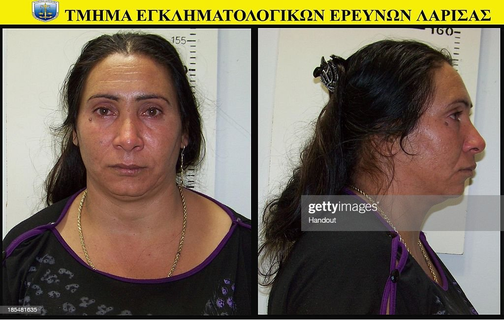 In this handout photo provided by the Hellenic Police, 40 year-old Selini Sali or Eleftheria Dimolpoulou poses for her mugshot on October 21, 2013. The Roma couple are due to appear in court today in Larissa, Greece, on charges of abducting the young girl, who was found on Wednesday October 16th, 2013, at a Roma settlement near Farsala in central during a police raid of the area for suspected drug trafficking.