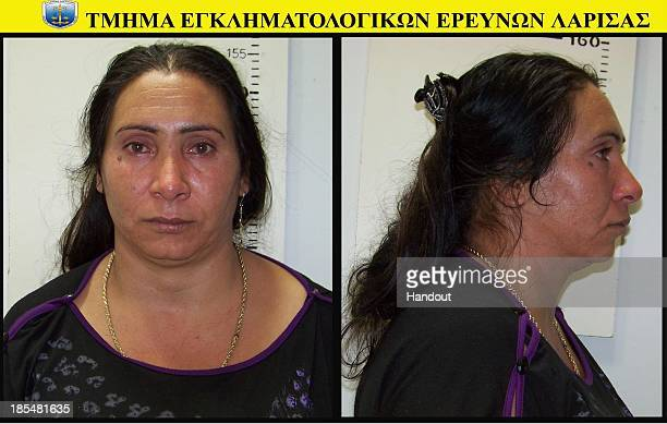 In this handout photo provided by the Hellenic Police 40 yearold Selini Sali or Eleftheria Dimolpoulou poses for her mugshot on October 21 2013 The...