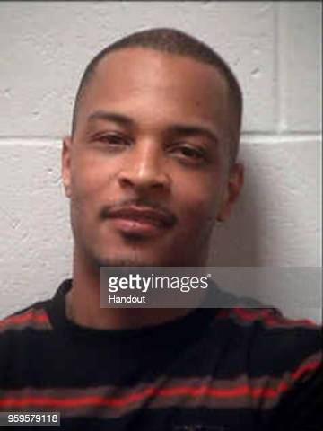 In this handout photo provided by the Henry County Sheriffs Office rapper TI whose real name is Clifford Harris Jr is seen in a police booking photo...