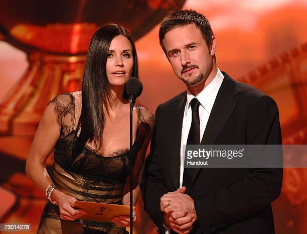 In this handout photo provided by the Hollywood Foreign Press Association, actors Courteney Cox and David Arquette present the award for Best...