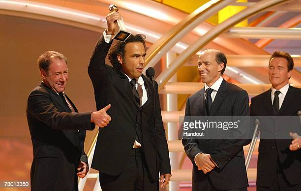 In this handout photo provided by the Hollywood Foreign Press Association director Alejandro Gonzalez Inarritu accepts his award for Best Motion...