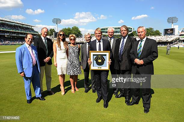 In this handout photo provided by the ICC Shane Warne of Australia is inducted into the ICC Hall of Fame and poses with parents Keith Bridgette Warne...