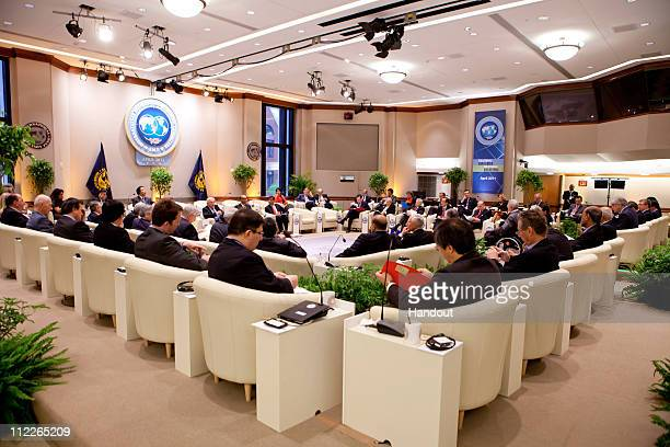In this handout photo provided by the IMF G20 Finance Ministers and Bank Governors have a breakfast meeting April 16 2011 at the IMF Headquarters in...