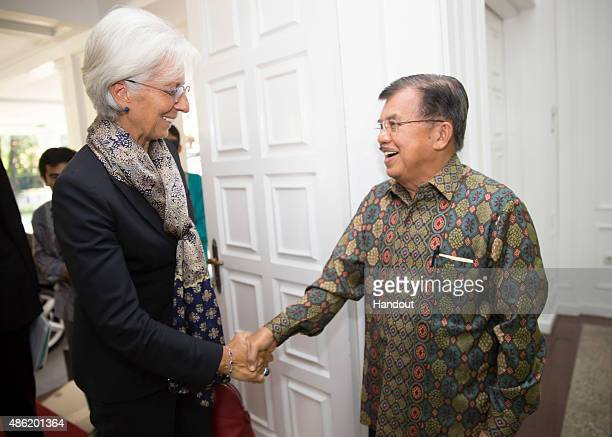 In this handout photo provided by the IMF, International Monetary Fund Managing Director Christine Lagarde is greeted by Indonesia Vice President...