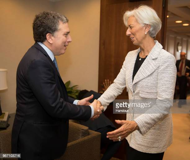 In this handout photo provided by the IMF International Monetary Fund Managing Director Christine Lagarde meets Argentine Treasury Minister Nicolas...