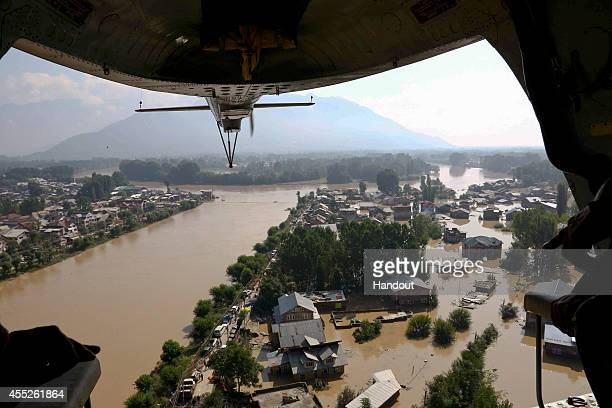 In this handout photo provided by the Indian Defence Ministry A view of residential houses submerged in flooded waters on September 10 2014 in...