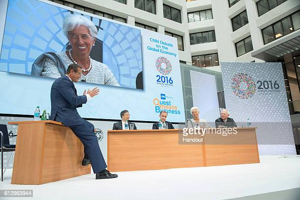 In this handout photo provided by the International Monetary Fund CNN Moderator Richard Quest Yi Gang Deputy Governor People's Bank of China Governor...