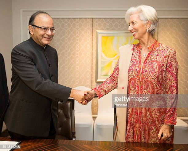 In this handout photo provided by the International Monetary Fund International Monetary Fund Managing Director Christine Lagarde and Indiaâs Finance...