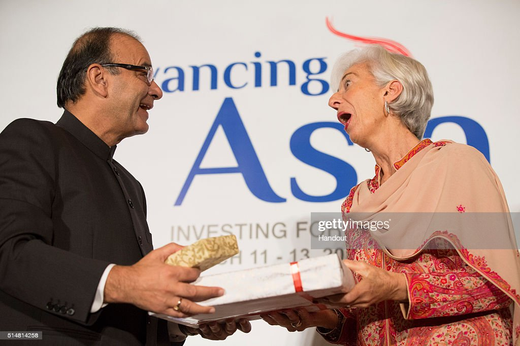 In this handout photo provided by the International Monetary Fund, International Monetary Fund Managing Director Christine Lagarde (R) exchange gifts with Indiaâs Finance Minister Arun Jaitley (L) at a reception to kick off the 'Advancing Asia, Investing for the Future' conference March 11, 2016 at the Taj Palace Hotel in New Delhi, India. The conference will held for 3 days; speakers to include India's Prime Minister Modi