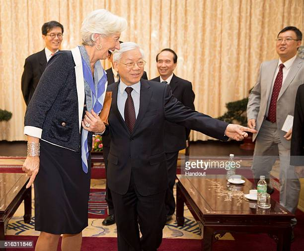 In this handout photo provided by the International Monetary Fund International Monetary Fund Managing Director Christine Lagarde laughs with General...