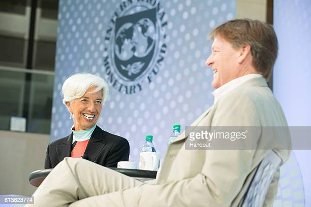 In this handout photo provided by the International Monetary Fund International Monetary Fund Managing Director Christine Lagarde and bestselling...