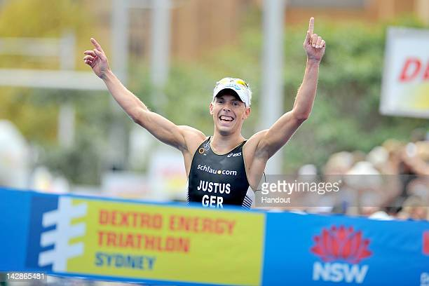 In this handout photo provided by the International Triathlon Union Germany's Steffen Justus captures the opening round of the 2012 ITU World...