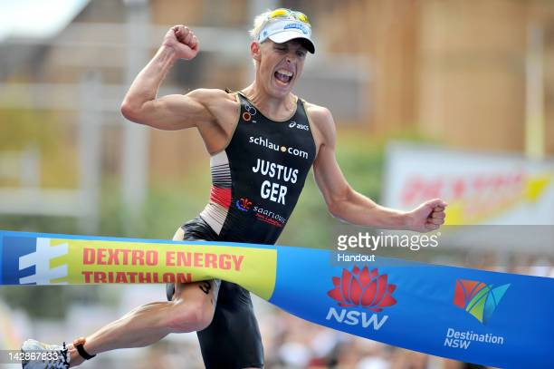 In this handout photo provided by the International Triathlon Union Germany's Steffen Justus pumps his fist as he celebrates victory at the opening...