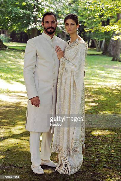 In this handout photo provided by The Ismaili Prince Rahim Aga Khan and Miss Kendra Salwa Spears pose together during their wedding ceremony on...