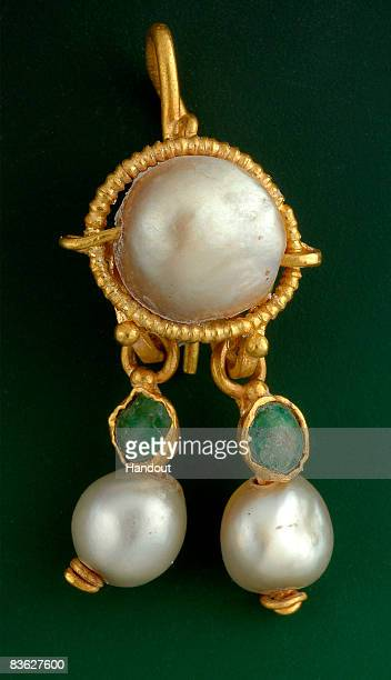 In this handout photo provided by the Israel Antiquities Authority on November 10 a 2000yearold gold earring inlaid with pearls and precious stones...