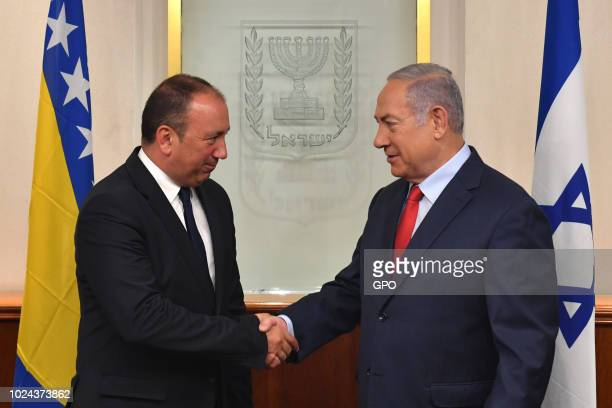 In this handout photo provided by the Israel Government Press Office Israeli Prime Minister Benjamin Netanyahu shakes hands with Igor Crnadak Bosnian...