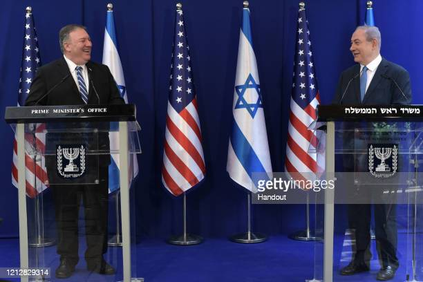 In this handout photo provided by the Israel Government Press Office Israeli Prime Minister Benjamin Netanyahu meets with US Secretary of State Mike...