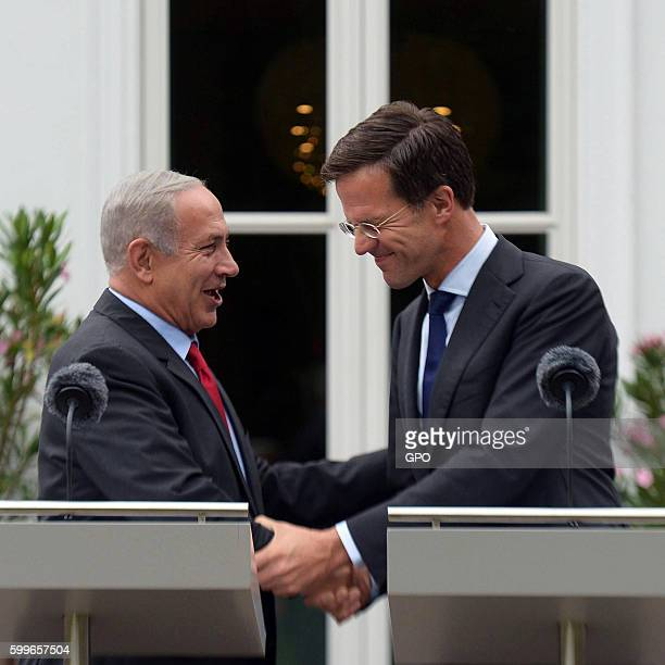 In this handout photo provided by the Israel Government Press Office Israeli Prime Minister Benjamin Netanyahu meets with Dutch Prime Minister Mark...