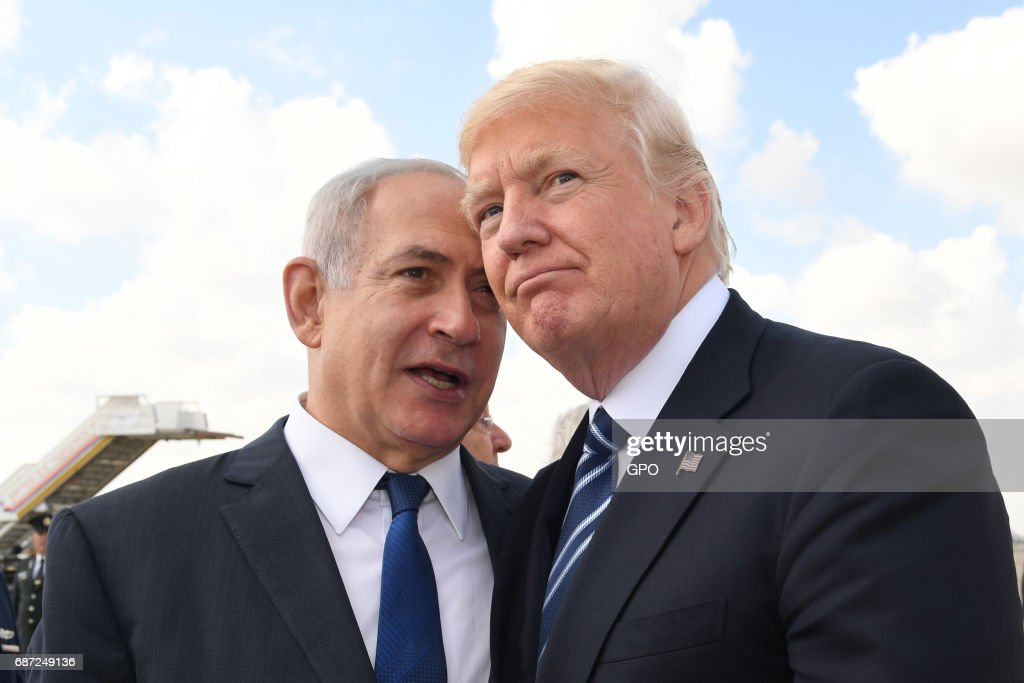 In this handout photo provided by the Israel Government Press Office (GPO), Israeli Prime Minister Benjamin Netanyahu speaks with US President Donald Trump prior to the President's departure from Ben Gurion International Airport in Tel Aviv on May 23, 2017 in Jerusalem, Israel. Trump arrived for a 28-hour visit to Israel and the Palestinian Authority areas on his first foreign trip since taking office in January.
