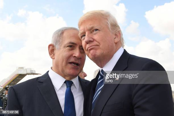 In this handout photo provided by the Israel Government Press Office Israeli Prime Minister Benjamin Netanyahu speaks with US President Donald Trump...