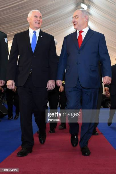 In this handout photo provided by the Israel Government Press Office US vice President Mike Pence walks with Israeli Prime Minister Benjamin...