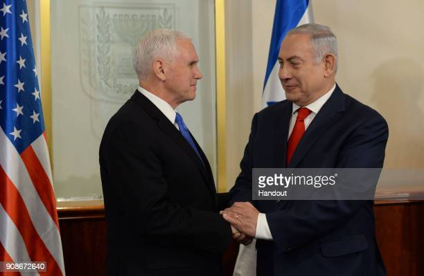 In this handout photo provided by the Israel Government Press Office US vice President Mike Pence meets with Israeli Prime Minister Benjamin...