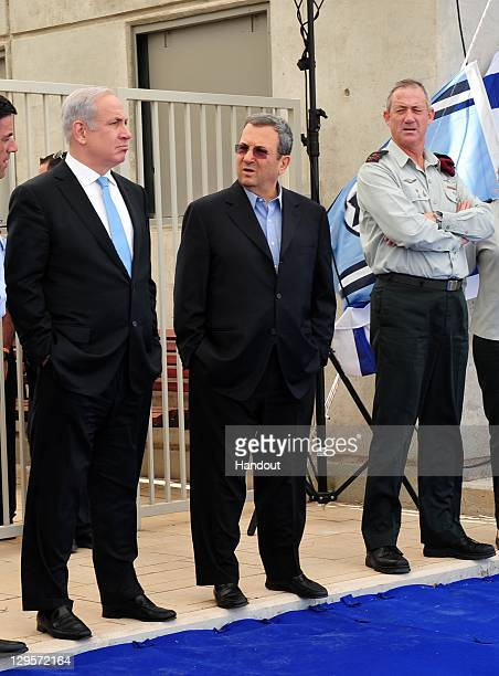 In this handout photo provided by the Israeli Defence Force Defence Minister Ehud Barak Israeli Prime Minister Benjamin Netanyahu and IDF Chief of...