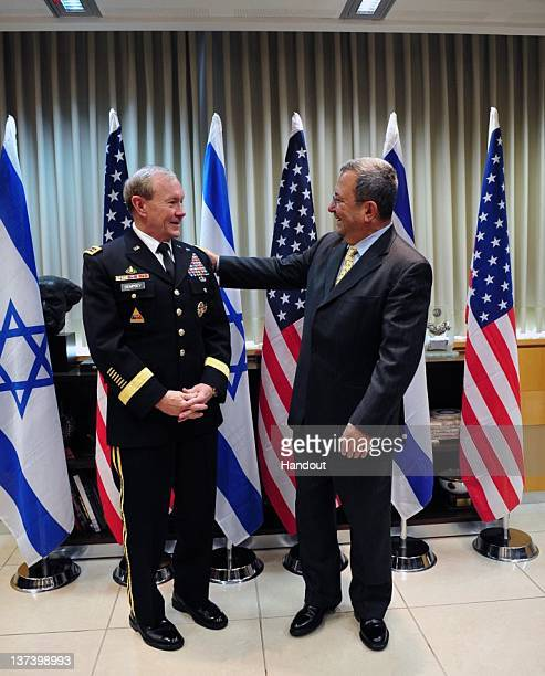 In this handout photo provided by the Israeli Defence Force Defence Minister Ehud Barak meets with Chairman of Joint Chiefs of Staff US Army General...