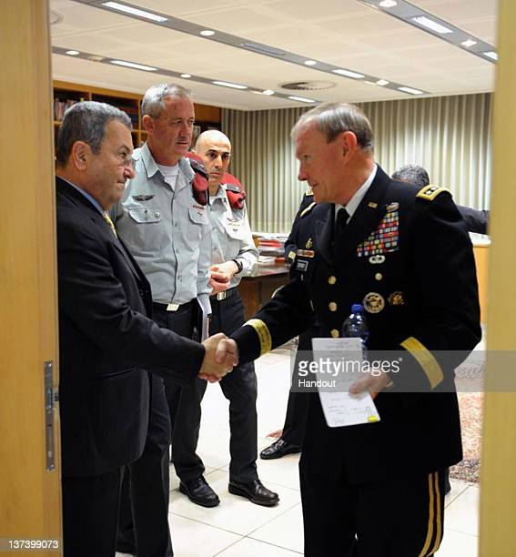 In this handout photo provided by the Israeli Defence Force Defence Minister Ehud Barak shakes hands with Chairman of Joint Chiefs of Staff US Army...