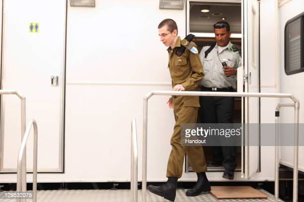 In this handout photo provided by the Israeli Defence Force freed Israeli soldier Gilad Shalit walks out at Tel Nof Airbase on October 18 2011 in...